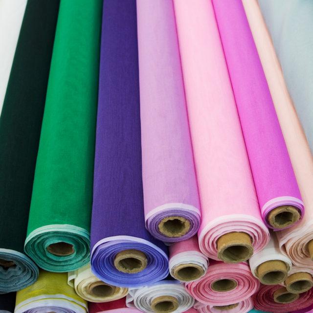 Colorful fabric rolls.